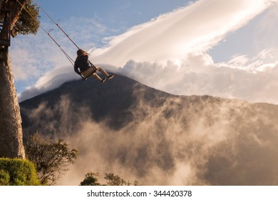 Young Caucasian Girl Taking A Ride On The Swing Located At Casa Del Arbol, South America