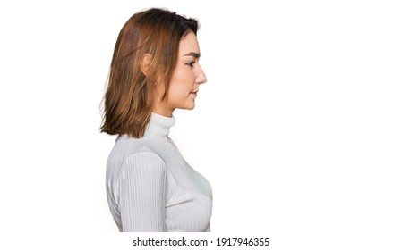 Young caucasian girl wearing casual clothes looking to side, relax profile pose with natural face with confident smile.