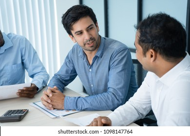 Young Caucasian leader talking to partner