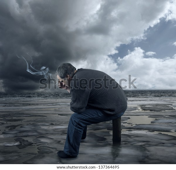A young caucasian man is alone, stressed, got fired from work is unemployed and sad.