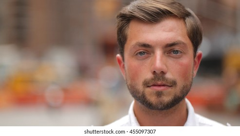 Young caucasian man in city face portrait