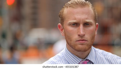 Young caucasian man in city face portrait