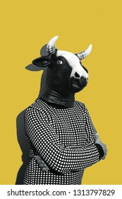 young caucasian man with a cow mask, in black and white, on a yellow background with some blank space on top