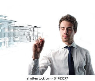 young caucasian man drawing house