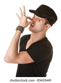 Young Caucasian man pinches his nose over white background