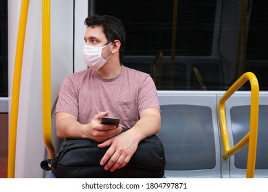 Young caucasian man wearing mask in the Madrid underground. Madrid underground, new normality.