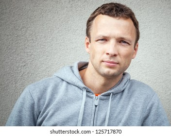 Young Caucasian man wears gray casual sport clothes