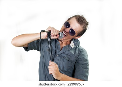 Young caucasian rock singer on the white background