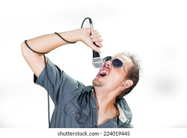 Young caucasian rock singer wearing sunglasses on the white background