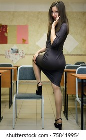 Young Caucasian Sexy Teacher In Glasses With Long Brown Hair In Pantyhose Stockings And High Heels