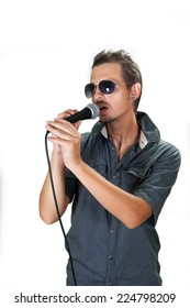 Young caucasian singer wearing sunglasses on the white background