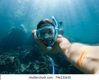 A young caucasian snorkeling man under water selfie, Koh Tao, Thailand
