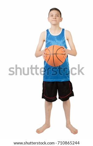 Young caucasian teenage boy with a basketball