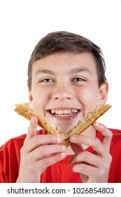 Young caucasian teenage boy with the crusts of a sandwich