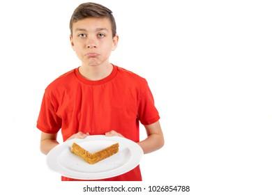 Young caucasian teenage boy doesn't like sandwich crusts