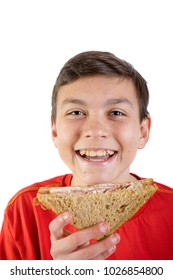 Young caucasian teenage boy eating a sandwich