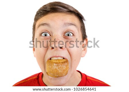 Young caucasian teenage boy eating a pork pie