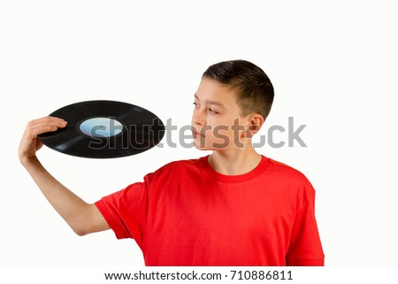 Young caucasian teenage boy holding a vinyl lp