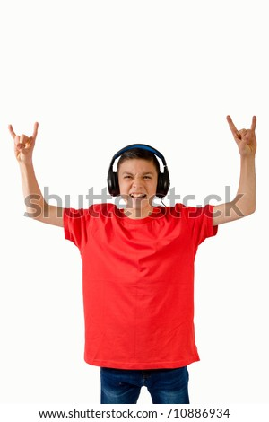 Young caucasian teenage boy listening to music
