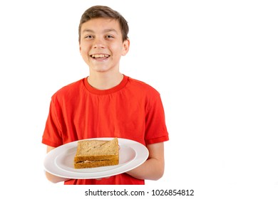 Young caucasian teenage boy with a sandwich on a plate