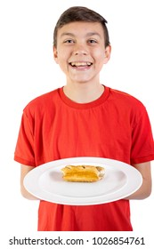 Young caucasian teenage boy with a sausage roll on a plate