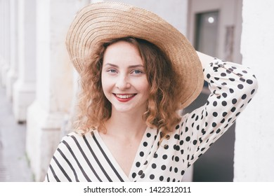 Young caucasian teenager with hat, traveling and loving the french riviera and nice city, fresh face, clean blurred backgorund.