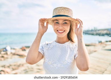 Young caucasian tourist girl smiling happy walking at the promenade.