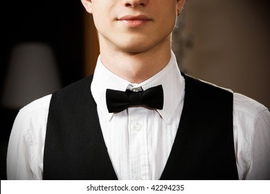 young caucasian waiter is wearing the uniform