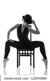 young caucasian woman ballet dancer in silhouette. Isolated over white