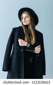 Young caucasian woman with black coat and hat