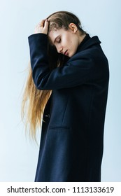 Young caucasian woman in black coat