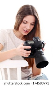 Young caucasian woman with camera isolated over white background