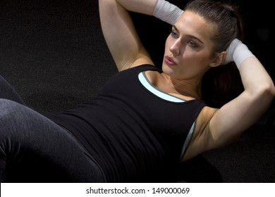 young Caucasian woman doing sit ups