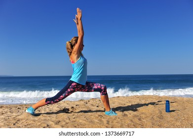 Young caucasian woman doing workout outdoors