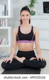 young caucasian woman doing yoga at home