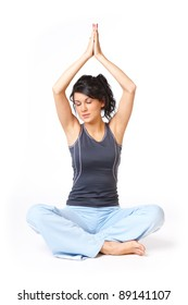 Young caucasian woman doing yoga exercise, isolated on white background