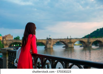 Young caucasian woman enjoy vie by The Charles Bridge background. Happy girl enjoy her weekend in european city