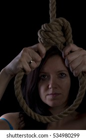 A young caucasian woman hanging suicide.