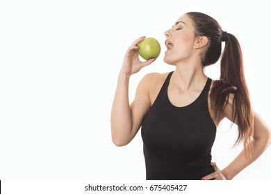 Young caucasian woman holding apple. Fitness and diet concept. Healthy lifestyle