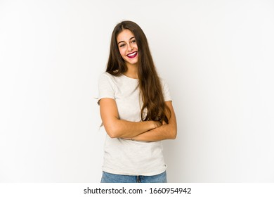 Young caucasian woman isolated on white background who feels confident, crossing arms with determination.