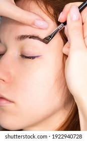Young Caucasian Woman on the brow beauty procedures. Professional care for face. Brows coloring, wax and lamination