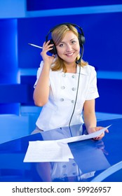 a young caucasian woman operator at a blue call center