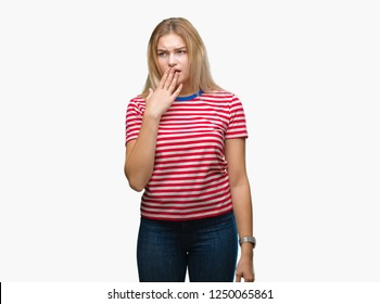 Young caucasian woman over isolated background bored yawning tired covering mouth with hand. Restless and sleepiness.