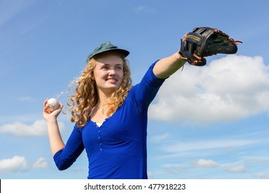 Young caucasian woman playing baseball with cap glove and ball