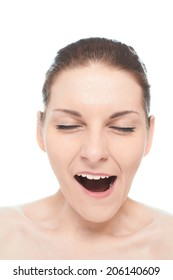 Young caucasian woman portrait with a yawning facial expression, isolated over the white background, natural make up and postprocessing