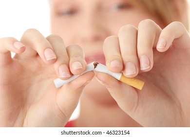Young caucasian woman quiting smoking isolated on white background