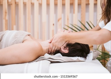 young caucasian Woman receiving back massage from physiotherapist female in clinic. Physiotherapy