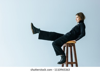 Young caucasian woman sitting on chair