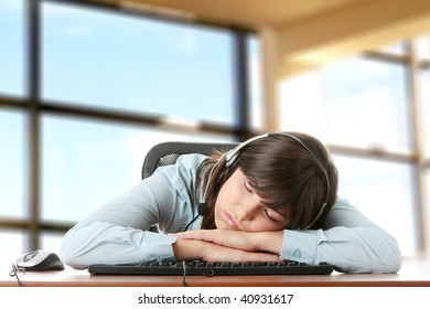 Young caucasian woman sleeping on keyboard