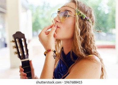 Young caucasian woman standing outdoor with cigarette - Beautiful girl smoking joint in summer day - Youth and freedom concept city life drugs cannabis legalization